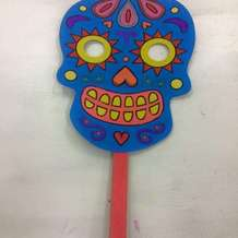 Day-of-the-dead-halloween-mask-decorating-1507123527